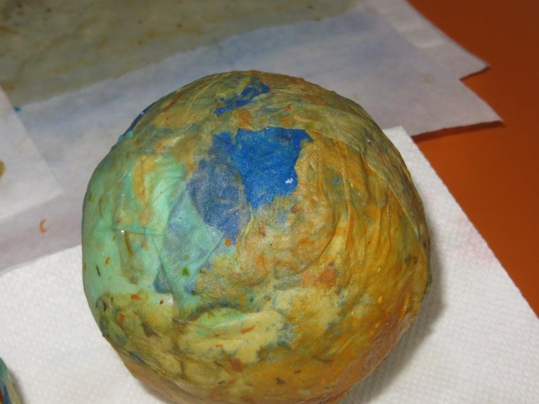 blue, green, and orange handmade paper over styrofoam ball