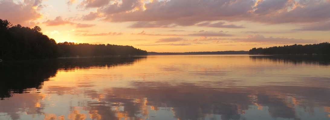 perfect reflection of clouds at sunset on Big Sand Lake, MN