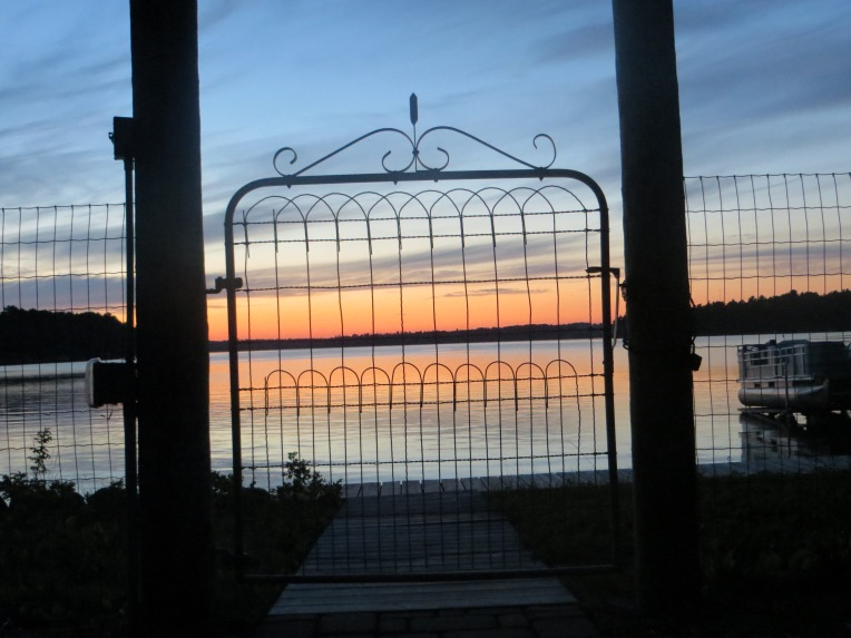 sunset on big sand lake through the garden walk gate