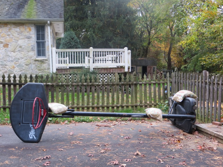basketball hoop laying in the driveway_preparing for Sandy