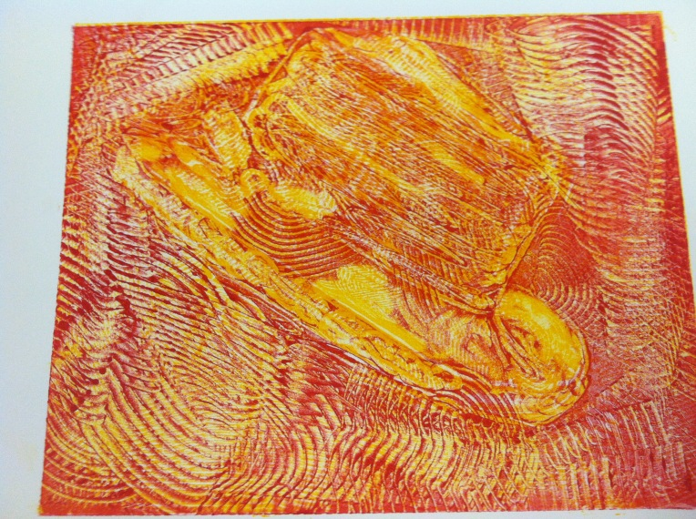 Monotype print - hat after yello and red layers of ink