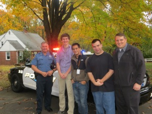 Police Officer, Boys, and Teachers in front of the Police Car