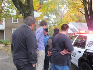 the guys problem solving and setting up the scene for the police car