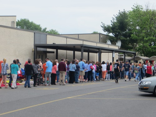 People in line in front of Pennsbury HS on Prom day