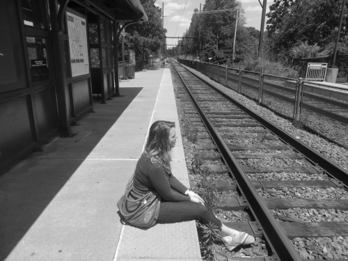 waiting for the train with feet on the tracks