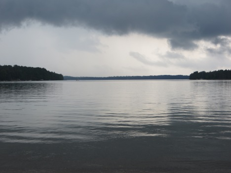 dark cloudy sky over the lake