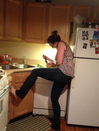 Katie cutting a spaghetti squash