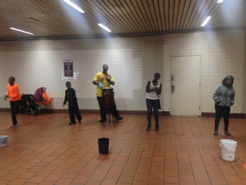 music performers in the train station