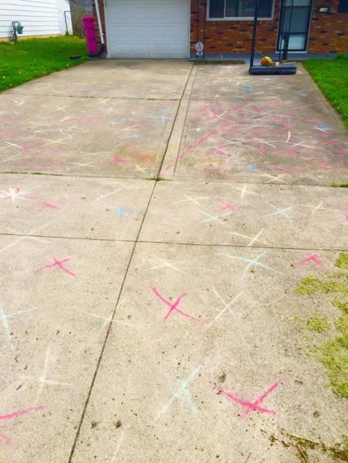 Driveway covered in sidewalk chalk