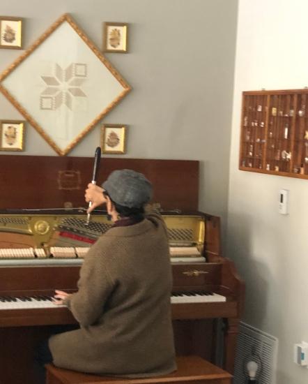Anna tuning Beth's Piano