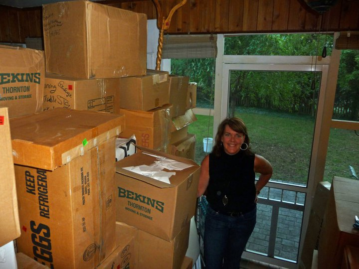 Beth surrounded by boxes on Pine Grove Road