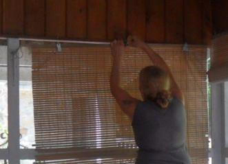 Maria taking down the broken blinds